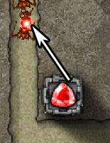 Gemcraft écran qui affiche un diamant en train de tirer sur un monstre